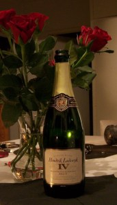 Du Preez Hendrik Lodewyk Brut with a vase of red roses