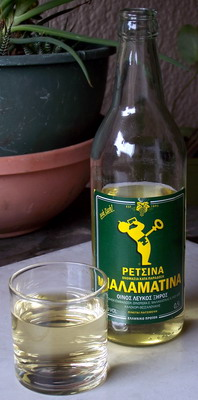 A bottle of Retsina with some poured into a glass
